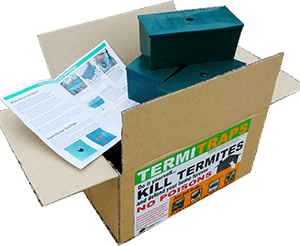 Cardboard box with the 12 packs of termite traps.