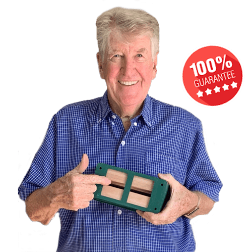 "Ion Staunton holding a termite traps which is 5-stars 100% Gurantee athat represents the ""termite control barriers"" blog."