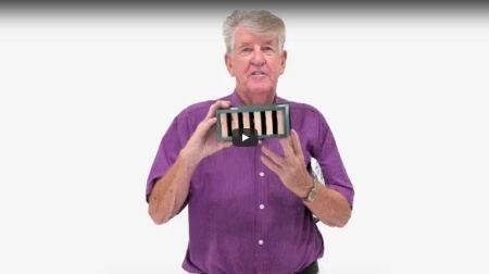 """Man (Ion Staunton) holding a box of termite trap and that represents the """"termites story in tv"""" blog."""