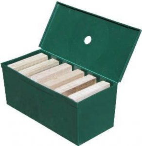 """Green box of Termite trap and a termite and that represents the """"termite traps under or on the ground"""" blog."""