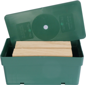 Closed-up of a DIY termite trap with 2 timbers inside a green box.