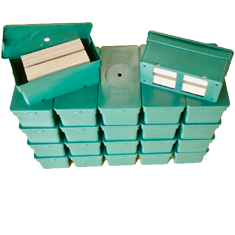 22 Green colored termite carton traps boxes piled-up.